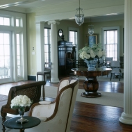 The living room's club chairs and caned chaise are new pieces chosen for their beauty as well as their durability.