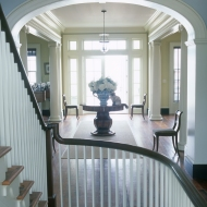As one ascends the 10'-wide, three-story staircase from the entry below, the view through the central corridor leads the eye out to the water and the broad horizon. The transverse arch has a historic precedent in this region of North Carolina.