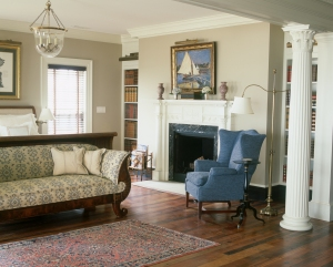 Franck created a tranquil master bedroom with views of the water and a classically styled fireplace. She reupholstered Davis's Biedermeyer sofa in a durable Schumacher fabric as a counterbalance to its formality.