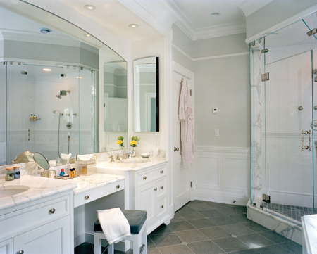 Off the second-floor central hall, the master suite consists of a bedroom, dressing room, master bath (pictured) and a large study.