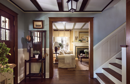 To lighten the atmosphere of the ground-floor entry, Brewer, working with interior sytlist Brice Gaillard, replaced missing beams, painted the woodwork and chose a Farrow & Ball painting scheme that highlights the original features. Photo: © Francis Dzikowski / Esto