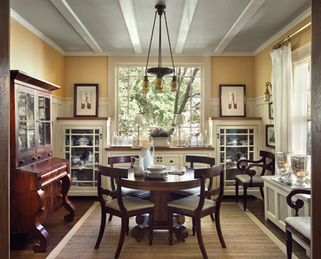 Brewer replaced the dining room's existing piano window, and installed new beams, wainscot, and light fixtures from Rejuvenation. He also designed a new built-in buffet in which to store his collection of antique English transfer ware. Photo: © Francis Dzikowski / Esto