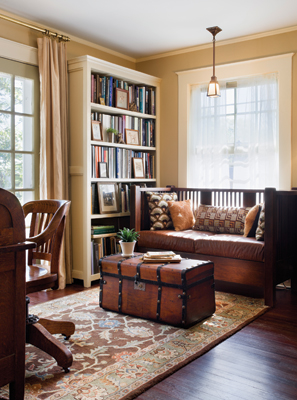 The study overlooks the porch and features new bookcases for Brewer's large collection of books on architecture and interior design, as well as artifacts culled from antique stores and flea markets. Photo: © Francis Dzikowski / Esto