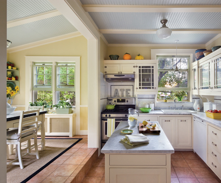 In three phases, the kitchen was transformed from busy 1970s to 1940s. Brewer retained the original cabinet boxes, which were painted white and fitted with new doors, trim and brackets. The wainscot, casing, island, built-in pantry and cabinet, and appliances are also new. Photo: © Francis Dzikowski / Esto