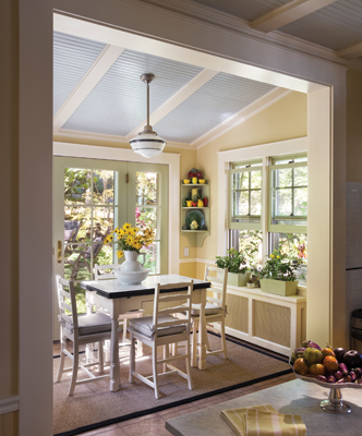 The breakfast bay's tiny windows were replaced with a new door, windows and sidelites by Marvin Windows & Doors that open the space to the back yard and flood the entire kitchen with natural light. Photo: © Francis Dzikowski / Esto